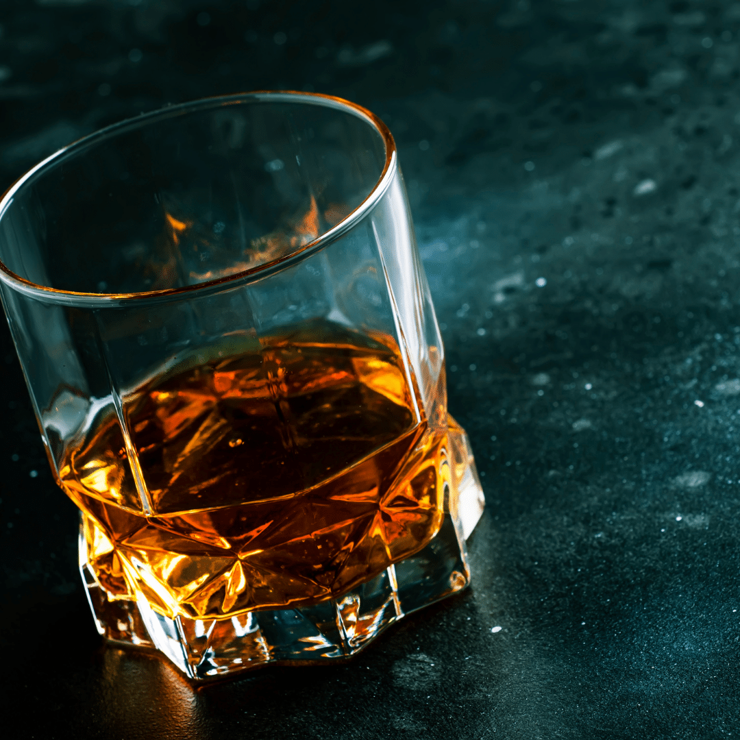 Glass of Bourbon on a table