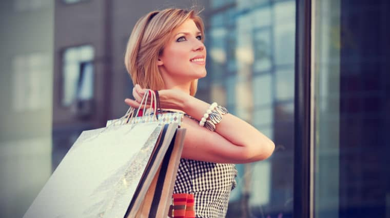 Happy Young Woman With Shopping Bags 3 760x425